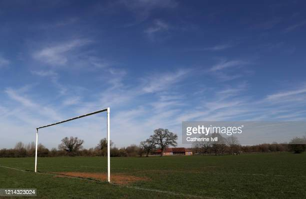 General view of goalposts on an empty football pitch on March 23, 2020 in Aylesbury, England. Coronavirus pandemic has spread to at least 182...