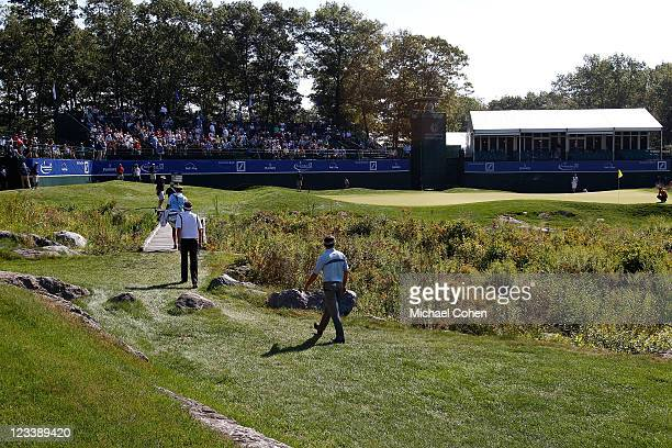 General view of golfers including, Keegan Bradley, as they walk up to the 18th hole green during the first round of the Deutsche Bank Championship at...