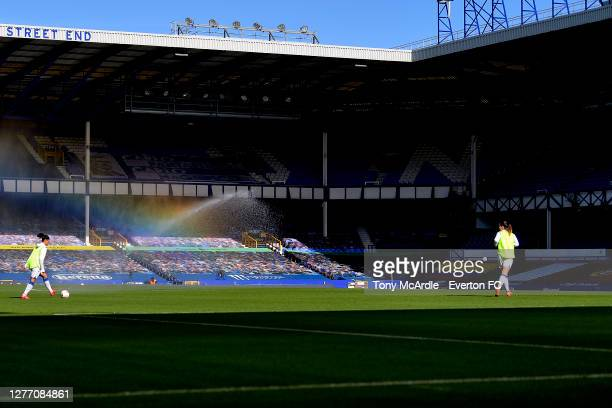 A general view of Goodison Park as Valerie Gauvin and Damaris Egurrola of Everton Women warm up at half time as a rainbow appears on the pitch during...
