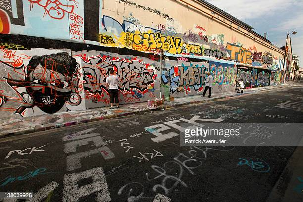 A general view of graffiti street art covering the main wall of the old Central Bus station at Rue des Pyrenees on January 7 2012 in Paris France The...