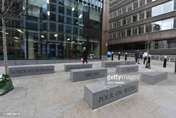 A general view of granite stone benches with 'London's Burning' rhyme engraved onto the surface which commemorate the Great Fire of London in...