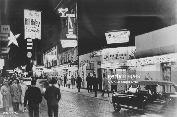 A general view of Grosse Freiheitwith a banner advertising Bill Haley and his Comets performing at the Star Club in the St Pauli district of Hamburg...