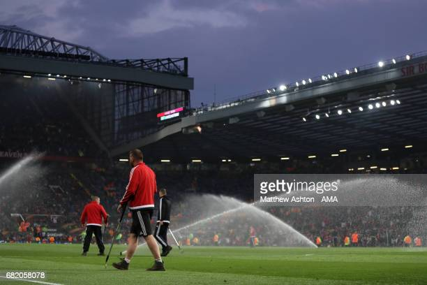 General View of ground staff and sprinklers during the UEFA Europa League semi final second leg match between Manchester United and Celta Vigo at Old...