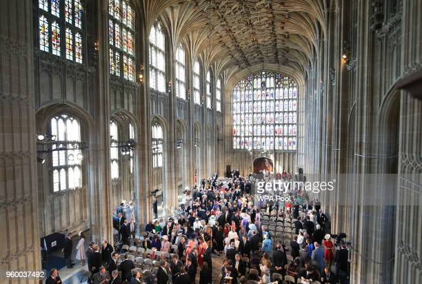 A general view of guests arriving in St George's Chapel at Windsor Castle for the wedding of Prince Harry to Meghan Markle on May 19 2018 in Windsor...