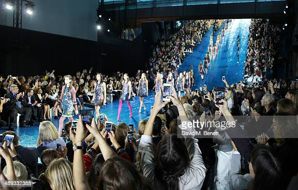 General view of guests taking photos on their mobile phones at the Mary Katrantzou show during London Fashion Week SS16 at Central Saint Martins on...