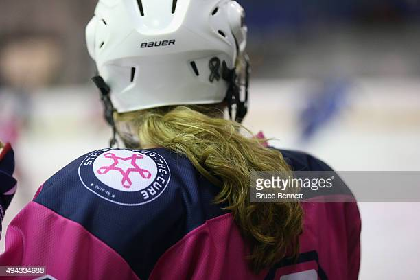 A general view of hair flowing out the back of a helmet belonging to a member of the New York Riveters of the National Womens Hockey League during...