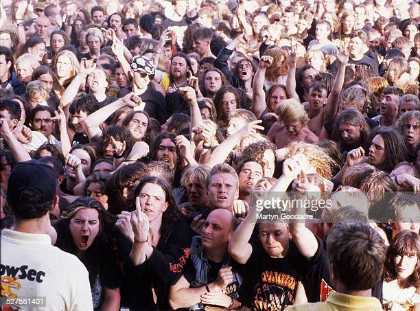 General view of heavy metal fans in the audience watcjing Sepultura perform on stage at Monsters Of Rock Donington Park United Kingdom 1994