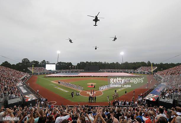 A general view of helicopters flying over Fort Bragg Field prior to the game between the Miami Marlins and Atlanta Braves on July 3 2016 in Fort...