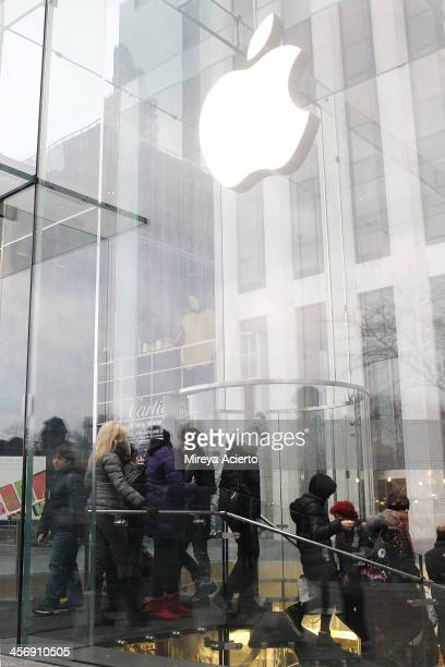 General view of holiday shoppers at the Apple Store Fifth Avenue on December 15 2013 in New York City
