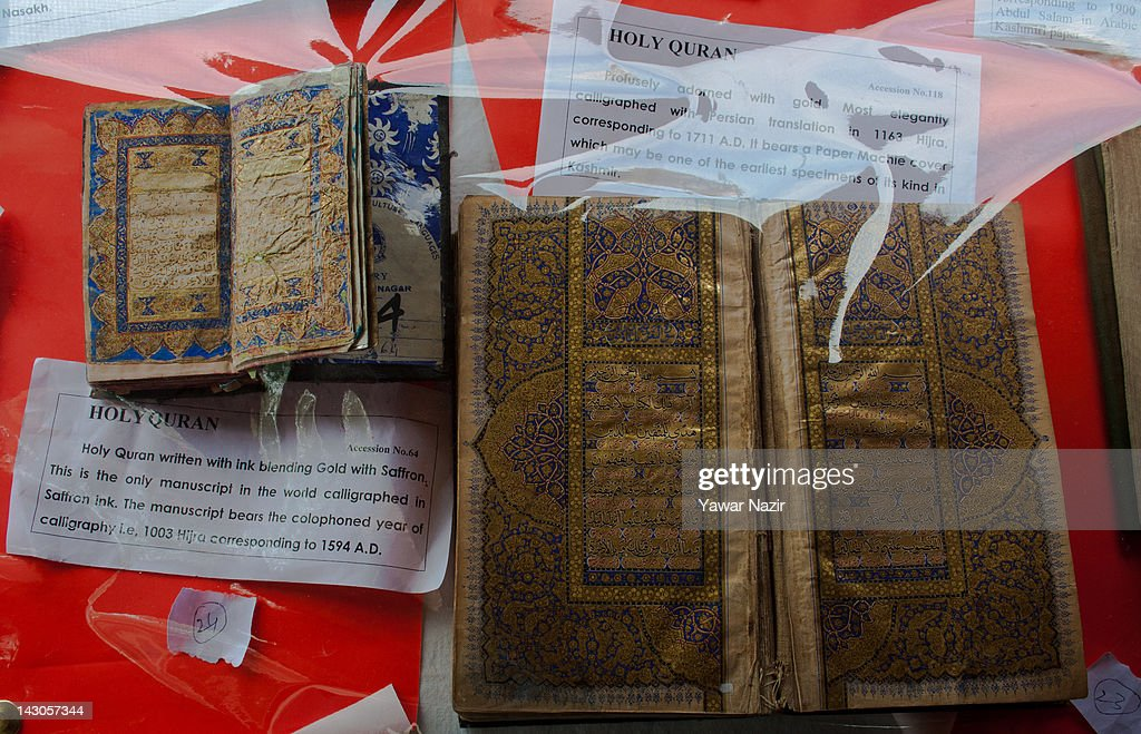 General view of Holy Quran with ink blending gold with