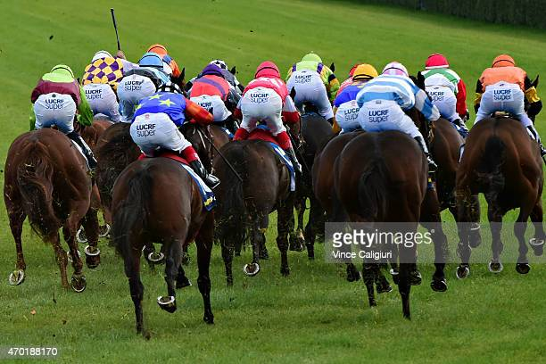 General view of horses running in the home straight in Race 4 during Melbourne Racing at Caulfield Racecourse on April 18 2015 in Melbourne Australia