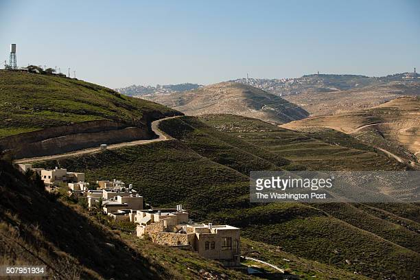 A general view of houses in Nofei Prat settlement and Jerusalem from a terrace overlooking Wadi Qelt at 'Nof Canaan' bed and breakfast which is...