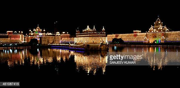 CONTENT] A general view of illuminated Golden Temple Amritsar India