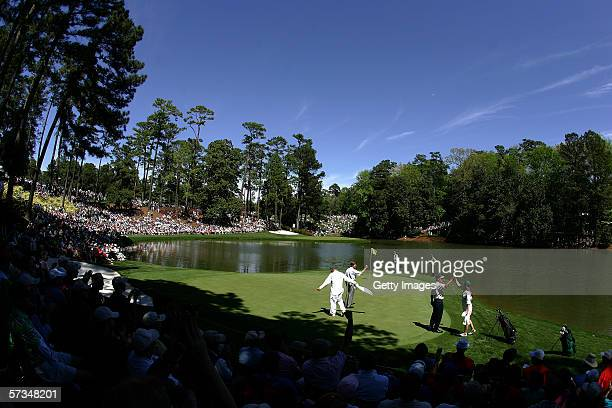 A general view of Jerry Pate Ben Crenshaw and Fred Riley on the 9th green during the 3 par contest prior to The Masters at the Augusta National Golf...