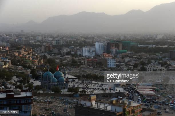 General view of Karte Sakhi shrine as people attend Friday prayers in Kabul on September 22 2017 / AFP PHOTO / NOORULLAH SHIRZADA