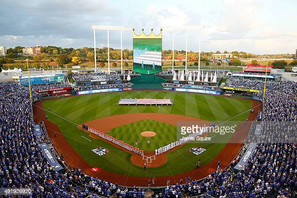 A general view of Kauffman Stadium as Julianna Zobrist wife of Ben Zobrist of the Kansas City Royals performs the national anthem prior to game one...