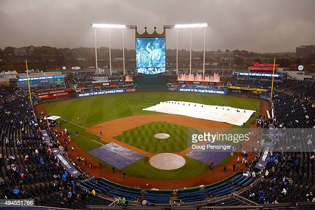 A general view of Kauffman Stadium as members of the Kansas City Royals grounds crew remove the infield tarp prior to Game One of the 2015 World...