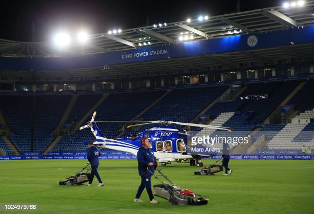 A general view of King Power Stadium as groundsman mow the pitch alongside the helicopter owned by Leicester City Chairman/owner Vichai...