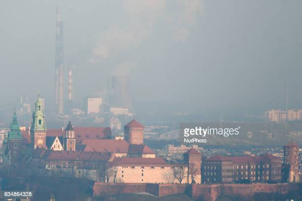 General view of Krakow's Wawel Castle and Nowa Huta's chimneys, seen from Krakus Mound on Saturday, the 11th of February, as the air pollution in...