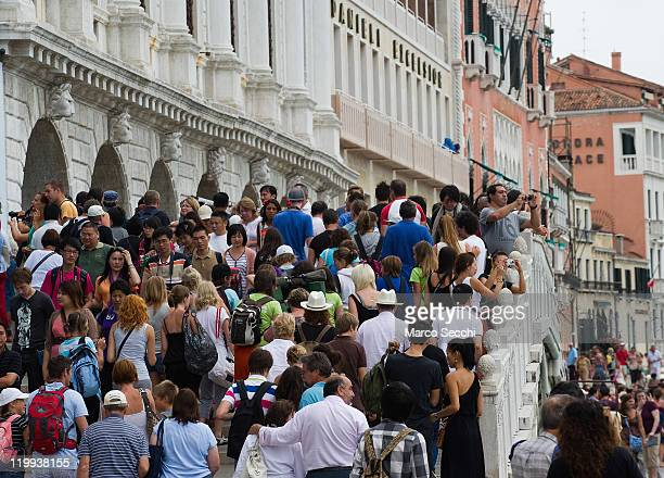 """General view of large crowds of tourists on the day when the municipality has opened seperate lanes for tourists and locals to access the """"vaporetto""""..."""