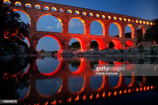 General view of Le Pont Du Gard illuminated with the light show on January 8 2012 in Nimes France At night the PontDuGard is transformed with a light...