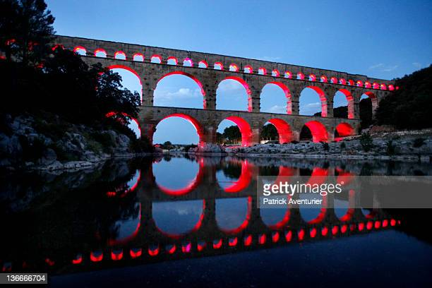General view of Le Pont Du Gard with the light show on August 18 2011 in Nimes France At night the PontDuGard is transformed with a light show...