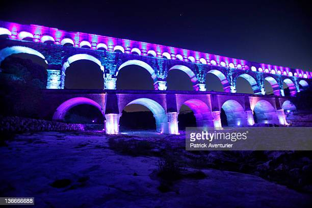 General view of Le Pont Du Gard with the light show on January 8 2012 in Nimes France At night the PontDuGard is transformed with a light show...