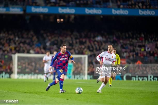 December 7: A general view of Lionel Messi of Barcelona defended by Joan Sastre of Mallorca during the Barcelona V Mallorca, La Liga regular season...