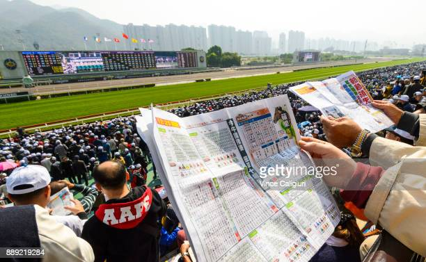 General view of local punters at the track during Longines Hong Kong International Race Day at Sha Tin Racecourse on December 10 2017 in Hong Kong...