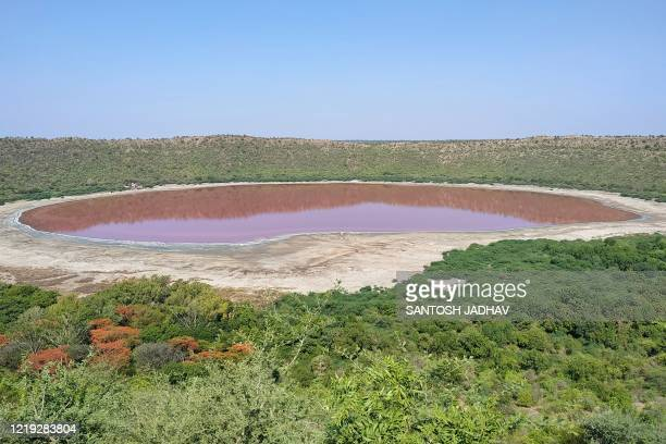 General view of Lonar crater sanctuary lake is pictured in Buldhana district of Maharashtra state on June 11, 2020. - The lake has turned pink in...