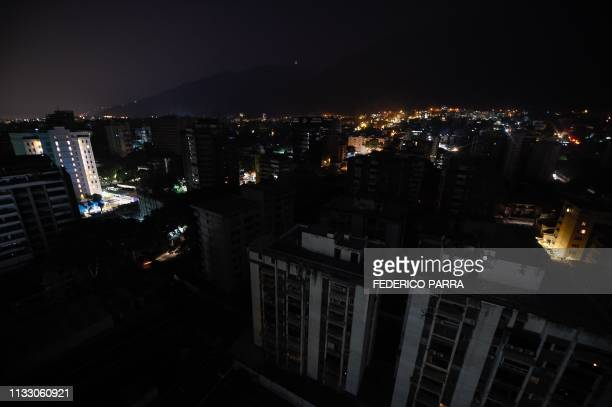 General view of Los Palos Grandes neighborhood partially illuminated during a power outage in Caracas Venezuela on March 26 2019 Venezuela decreed a...