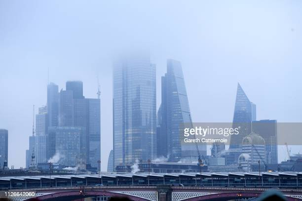 A general view of low clouds shrouding the skyscrapers of the city on February 01 2019 in London England