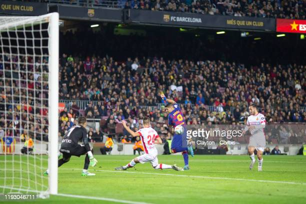 December 7: A general view of Luis Suarez of Barcelona scoring with an incredible back heal shot to beat goalkeeper Manolo Reina of Mallorca to score...