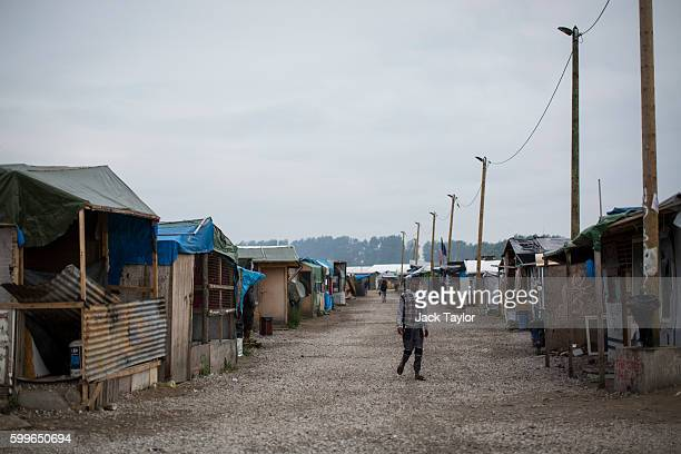 A general view of makeshift shops and shelters by the Jungle Books Cafe at the Jungle migrant camp on September 6 2016 in Calais France The dropin...