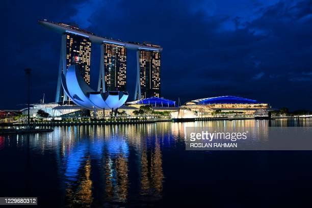 General view of Marina Bay Sands hotels and resorts is seen lit-up in Singapore on November 19, 2020.