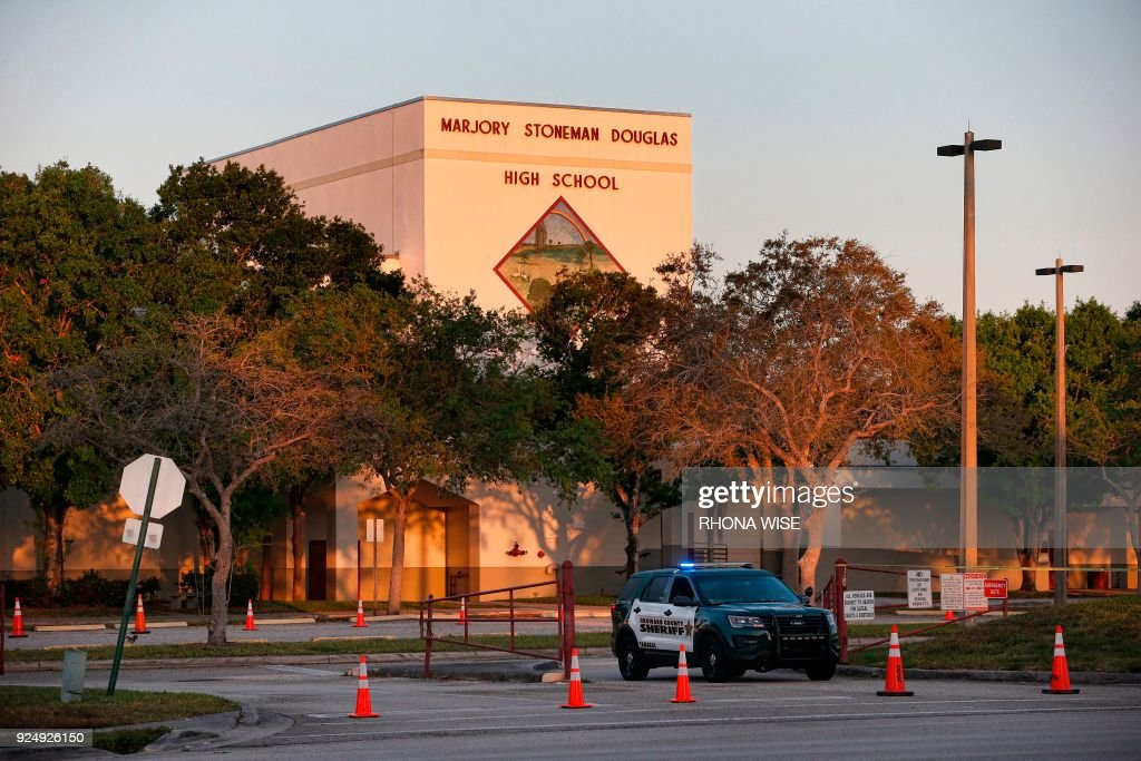 A general view of Marjory Stoneman Douglas High School as staff and teachers prepare for the return of students in Parkland, Florida on February 27, 2018. Florida's Marjory Stoneman Douglas high school will reopen on February 28, 2018 two weeks after 17 people were killed in a shooting by former student, Nikolas Cruz, leaving 17 people dead and 15 injured on February 14, 2018. /
