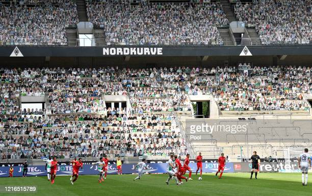 General view of match action as cardoard cut outs of fans are seen in the stands during the Bundesliga match between Borussia Moenchengladbach and 1....