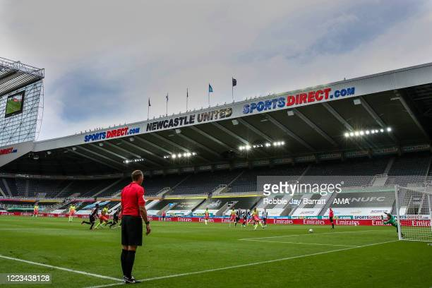 A general view of match action at and empty StJames Park home stadium of Newcastle United as Kevin De Bruyne of Manchester City scores a penalty to...