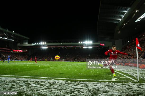 A general view of match action at Anfield the home stadium of Liverpool as Xherdan Shaqiri of Liverpool takes a corner in the snow during the Premier...