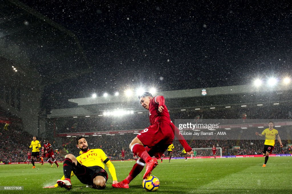 General view of match action at Anfield, the home stadium of Liverpool under snow during the Premier League match between Liverpool and Watford at Anfield on March 17, 2018 in Liverpool, England.