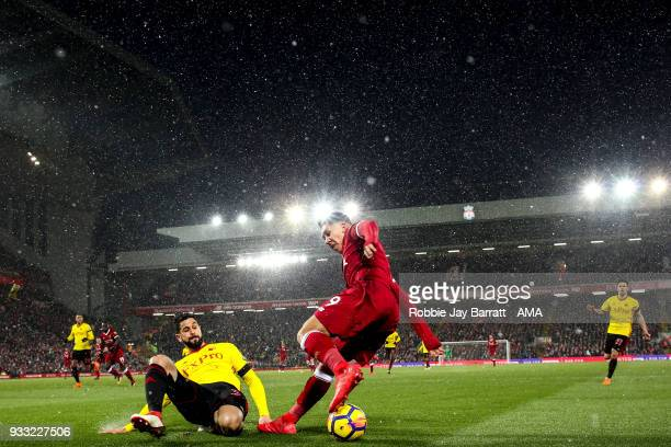 General view of match action at Anfield the home stadium of Liverpool under snow during the Premier League match between Liverpool and Watford at...