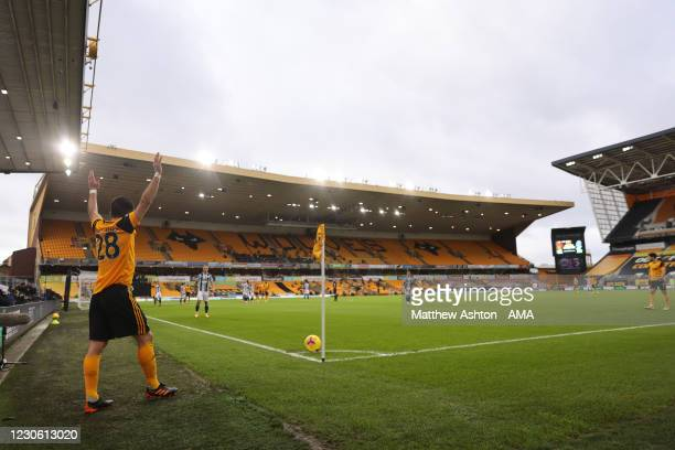 General view of match action at Molineux Stadium, home stadium of Wolverhampton Wanderers as Joao Moutinho of Wolverhampton Wanderers takes a corner...
