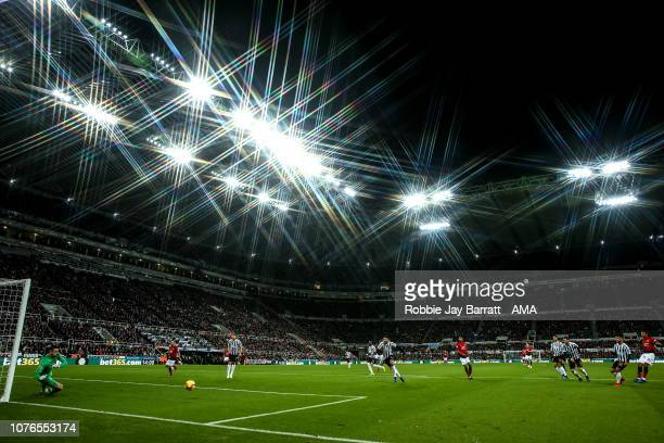 A general view of match action at St James Park home stadium of Newcastle United as Anthony Martial of Manchester United has a shot at goal during...