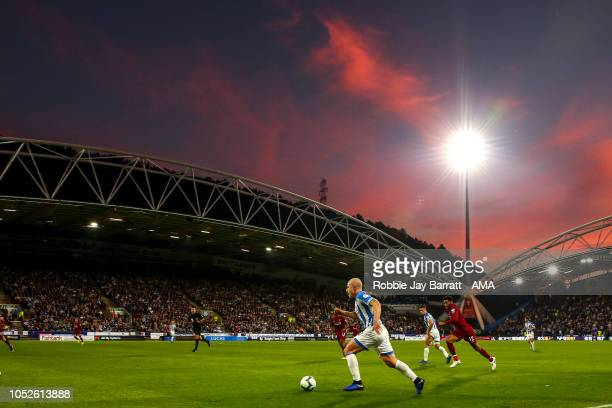 A general view of match action at The John Smiths Stadium home stadium of Huddersfield Town during a sunset during the Premier League match between...