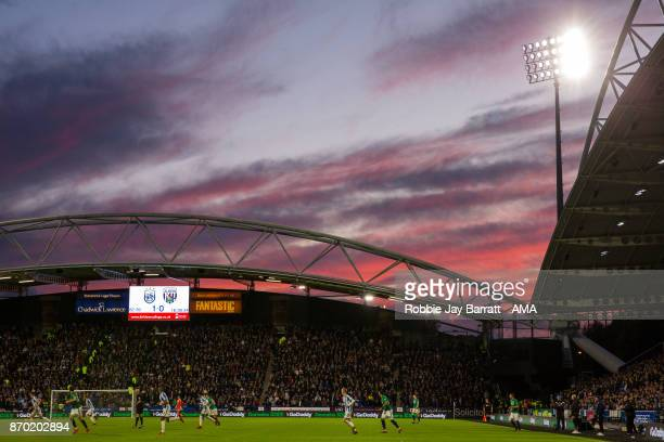 General view of match action at The John Smiths Stadium home stadium of Huddersfield Town under a sunset during the Premier League match between...