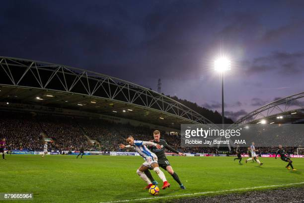 General view of match action at The John Smiths Stadium home stadium of Huddersfield Town at dusk during the Premier League match between...