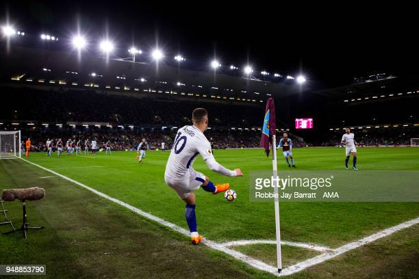 General view of match action at Turf Moor the home stadium of Burnley as Eden Hazard of Chelsea takes a corner during the Premier League match...