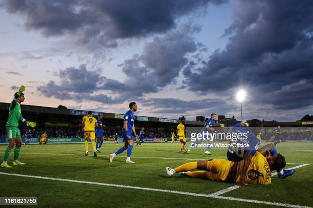 A general view of match action beneath the evening sky at the Cherry Red Records Stadium during the Carabao Cup First Round match between AFC...