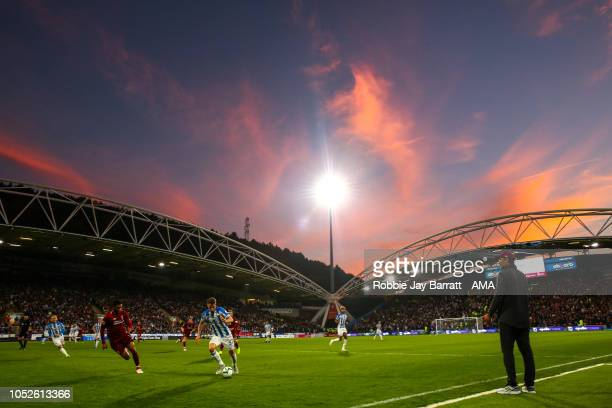 General view of match action during sunset during the Premier League match between Huddersfield Town and Liverpool FC at John Smith's Stadium on...