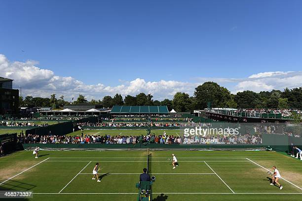 A general view of match action on the outdoor courts on day six of the Wimbledon Lawn Tennis Championships at the All England Lawn Tennis and Croquet...